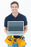 Happy architect holding laptop Stock Photos