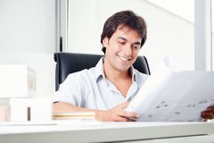 Happy Architect Looking at Blueprints Royalty Free Stock Photo