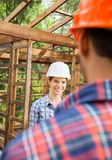Happy Architect Looking At Colleague Stock Photos