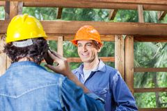 Happy Architect Looking At Colleague Using Royalty Free Stock Images