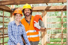 Happy Architect Standing With Worker In Incomplete stock photo
