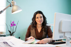 Happy architect woman at her office desk Royalty Free Stock Photography