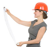 Happy architect woman looking on flipchart Royalty Free Stock Photos