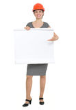 Happy architect woman pointing on blank flipchart Royalty Free Stock Image