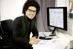 Happy architect at work in office smiling Stock Photos