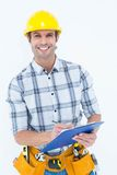 Happy architect writing notes on clip board Royalty Free Stock Images