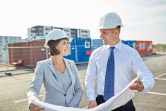 Happy architects with blueprint at building Stock Photography