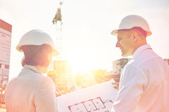 Happy architects with blueprint at building Royalty Free Stock Photos