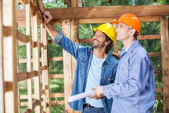 Happy Architects Discussing At Construction Site Royalty Free Stock Images