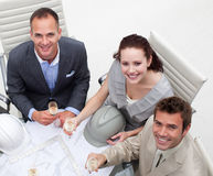 Happy architects drinking champagne in the office Royalty Free Stock Images