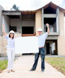 Happy architects holding a banner Stock Images