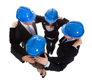 Happy architects making huddle Stock Photo
