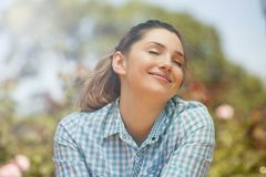 Argentinian woman smiling outdoors enjoying nature Stock Photo