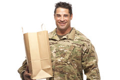 Happy army soldier with shopping bag Stock Photography