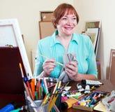 Happy artist draws Stock Photos