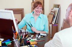 Happy artist draws Royalty Free Stock Photography