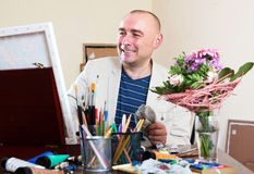 Happy artist draws. The young artist draws beautiful portrait Royalty Free Stock Photos