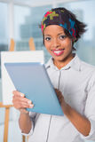 Happy artist using tablet Stock Photography
