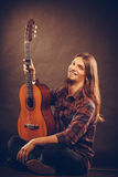 Happy artist with wooden guitar. Royalty Free Stock Photography