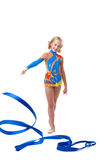 Happy artistic gymnast posing with ribbon Royalty Free Stock Photos