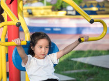 Happy asian baby child playing on playground Stock Images
