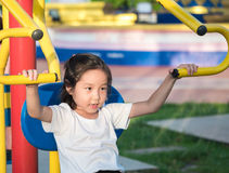 Happy asian baby child playing on playground Royalty Free Stock Images