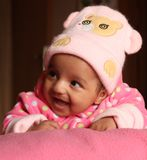 Happy asian baby girl in pink winter cap Royalty Free Stock Image