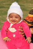 Happy asian baby girl in white winter cap Royalty Free Stock Photography