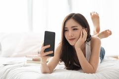 Happy Asian Beautiful female using cell phone royalty free stock photo