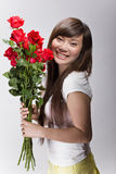Happy asian beauty with roses Royalty Free Stock Photos