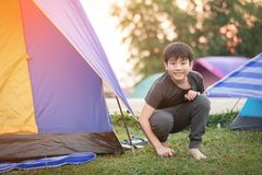 Happy asian boy in camping tent in summer forest. Happy asian boy is in camping tent in summer forest stock photography