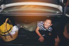 Happy Asian boy in in car truck. Stock Photo