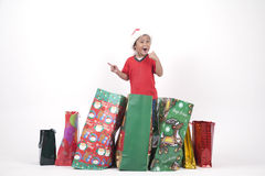 Happy Asian Boy with Christmas Gifts. Asian Boy with Christmas bags isolated on white Royalty Free Stock Photo