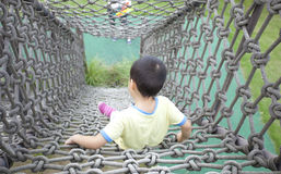 Happy asian boy climb sport in adventure park Royalty Free Stock Image