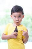 Happy asian boy eating ice-cream. Royalty Free Stock Images