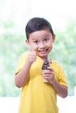 Happy asian boy eating ice-cream. Royalty Free Stock Photo
