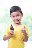 Happy asian boy eating ice-cream. Stock Image