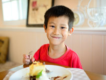 Happy Asian boy enjoy cake Stock Image