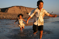 Happy Asian Boy & Girl on the beach Stock Photography