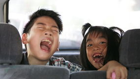 Happy asian boy and girl looking at camera and smiling. stock footage