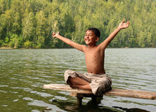 Happy asian boy with hands up Stock Photos