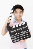 Happy asian boy holding clapper board in hands. Cinema concept Royalty Free Stock Images