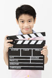 Happy asian boy holding clapper board in hands. Cinema concept Stock Photography