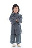Happy asian boy in kimono sitting on white background Stock Photography