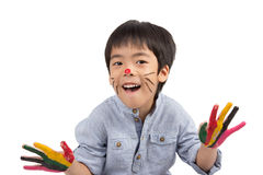 Happy asian boy with painted face. Asian boy with colorful painting isolated on white background stock photo