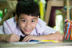 Happy asian boy painting and drawing  at home Royalty Free Stock Image