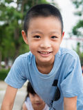 Happy asian boy playing on playground Royalty Free Stock Photos