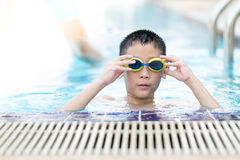 Happy asian boy playing in the pool Royalty Free Stock Photo