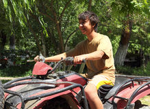 Happy asian boy on quad bike atv Royalty Free Stock Image