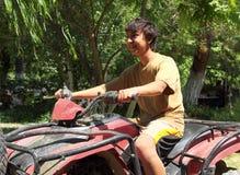 Happy asian boy on quad bike atv. Happy asian boy sitting on quad bike atv Royalty Free Stock Image